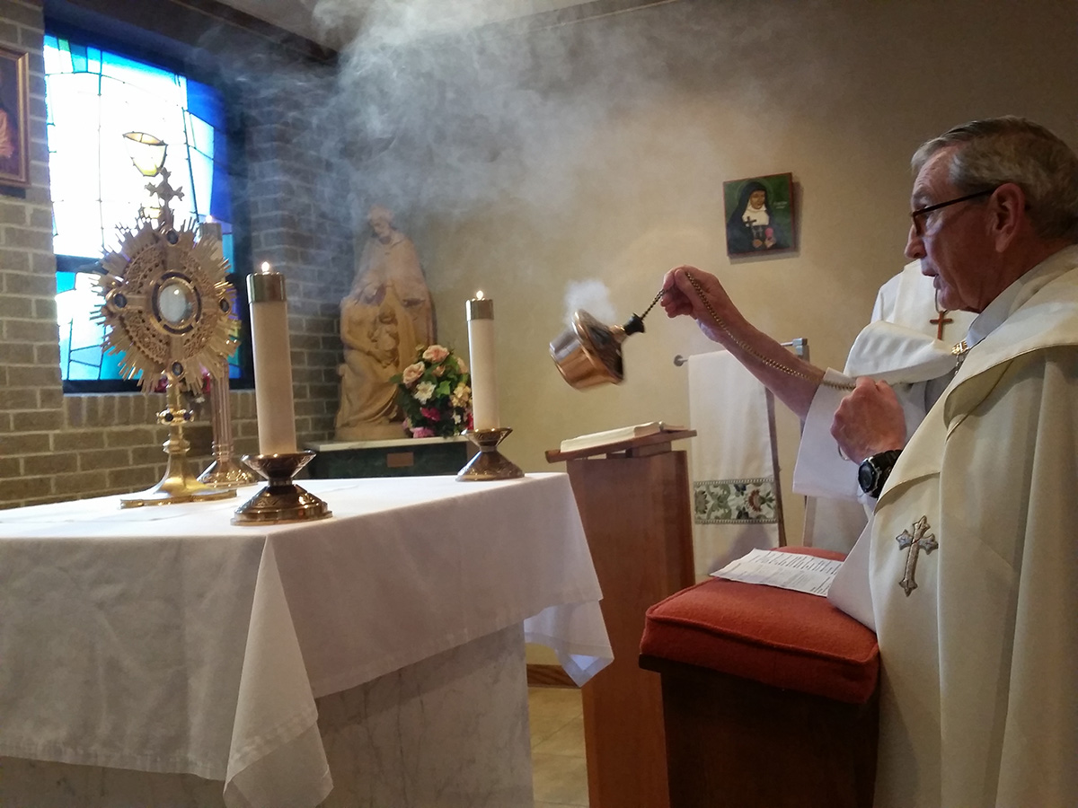 Eucharistic Adoration, Fr. Carl incensing